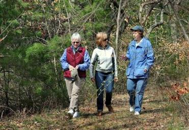 Gail Briggs, Jane Schulze, and Linda Leddy, all members of Plympton's Open Space Committee, walk through a site slated to be a conservation and recreation area.